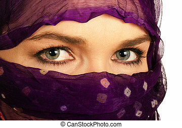 Closeup of a beautiful Indian or asian woman wearing a veil