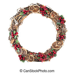 christmas wreath with berries, holly and cinnamon sticks...