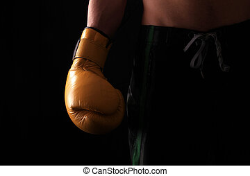 boxing glove - male boxer with arm down by his side wearing...