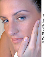skin care - portrait of a young woman with clear skin