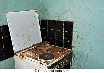 last meal - Dirty cook stove and moldy wall. Abandoned house...