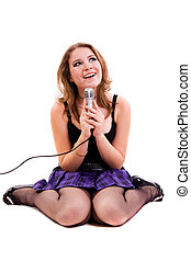 Singer. Young girl singing into microphone.