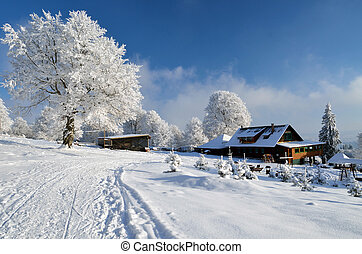 Idylic winter landscape with wooden chalet - Old chalet...