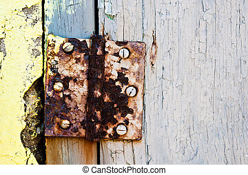 Rusty door hinge - Old and rusty door hinge with yellow and...