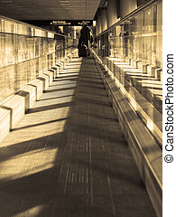 Moving sidewalk - Moving walkway in an airport, with light...