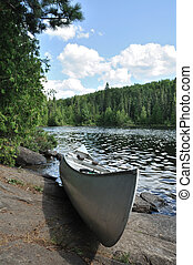 Canoe on the Shore of a Remote Wilderness Lake - Aluminum...
