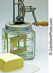 butter churn with a pice of butter