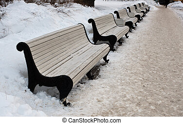 winter street - Empty benches on street in cold winter day