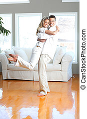 Couple at home - Young happy couple in love at home