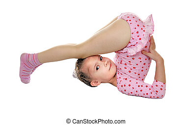 Gymnastic exercise - 6-year-old girl performs a difficult...
