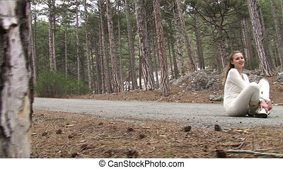 Girl resting on the road