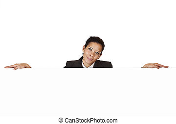 Young happy woman leans on blank billboard