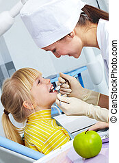Dental checkup - Image of dental checkup given to little...