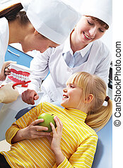Teaching dental hygiene - Photo of dentist teaching care...