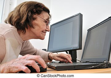 Never old enough - senior woman with computer - 80-something...