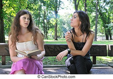 Young people lifestyle - annoying by smoking cigarette - Two...