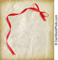 Red ribbon on old paper