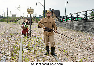 Lady and soldier with gun in retro style picture - Lady and...