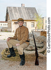 Retro style picture with soldier sitting on the rope -...