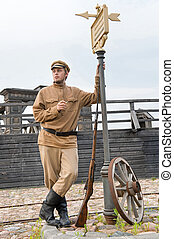 Retro style picture with soldier at tram stop. - Soldier...