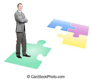 Solving a puzzle - Businessman solving a puzzle
