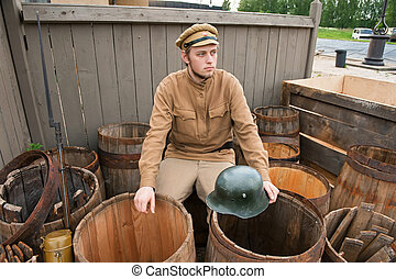 Retro style picture with soldier sitting on the butt -...