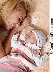 Mother with babe - Mother with her newborn baby in home