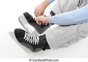 hockey skates. - Man tying shoelaces hockey skates. Isolated...