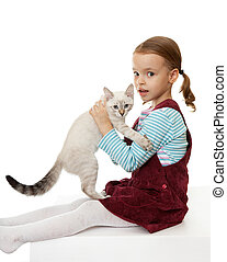 Beautiful little girl with a kitten. On the eastern calendar...
