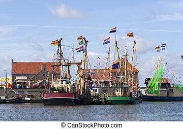 Fishing boats in a Dutch harbor - Fishing boats with flags...