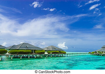 Waterfront resort Maldives - Buildings at a luxurious...