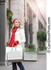Caucasian woman shopping - A shopping caucasian woman...