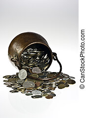 Old pot with coins - Old copper pot with coins on white