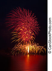 vertical red and yellow fireworks - celebration of colourful...