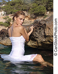 young sexy girl in water - young sexy girl in a white dress...