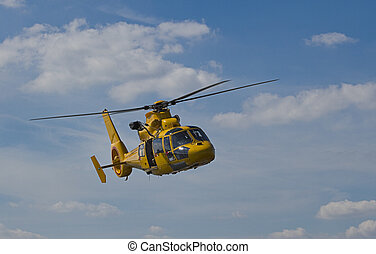 Yellow Helicopter flight - Flight of yellow helicopter in...