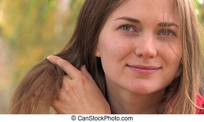 Mysterious smile of Beautiful Young Woman, closeup, Canon XH...