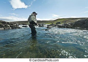Flyfishing - Fly fisherman casting the fly in beautiful...