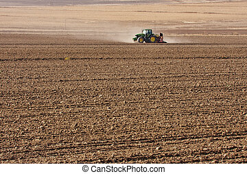 tractor planting wheat - tractor on agriculture field...