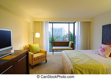 Hotel Room - Bed and furniture in a hotel resort.