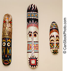 African Masks on a Wall - African masks on a cream colored...
