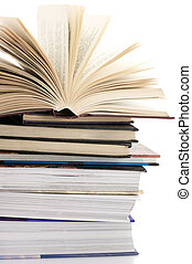 Stack of books - Open book on stack of various books against...