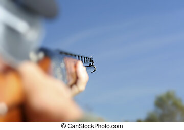 Looking Down the Barrel - Extreme depth of field. Man aiming...