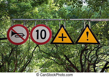Four road signs with warning and speed limit