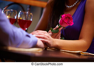 During Valentines day - Close-up of female holding a red...