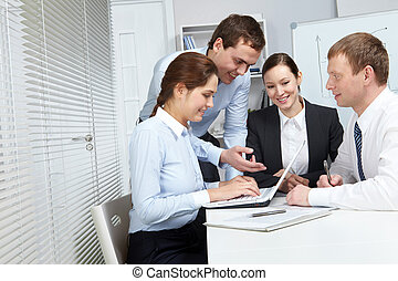 Hard-working team - Four business people making their...