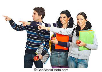 Group of students pointing to copy - Group of three students...