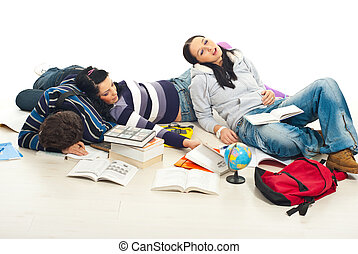 Tired students sleeping on floor - Three tired students fall...