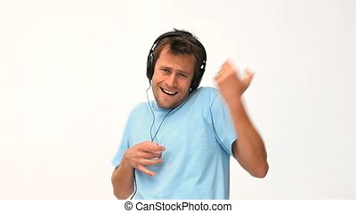 Man listening to music against a white background