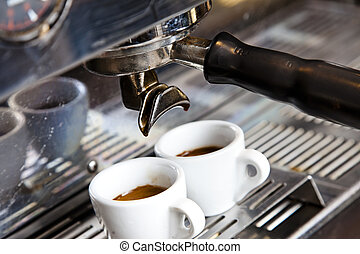 Espresso Machine - Close-up of two cups of fresh made...
